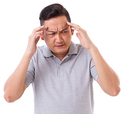 Man holding his temples suffering from a Migraine.